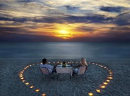 young couple share a romantic dinner on the beach