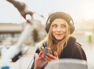 Teenage girl listening music with smartphone